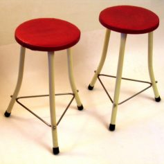 Two red and white Brabantia stools