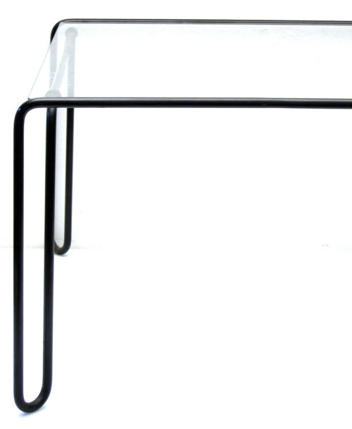 Fifties vintage design metal and glass side tables. Minimal styled metal retro tables with glass top.