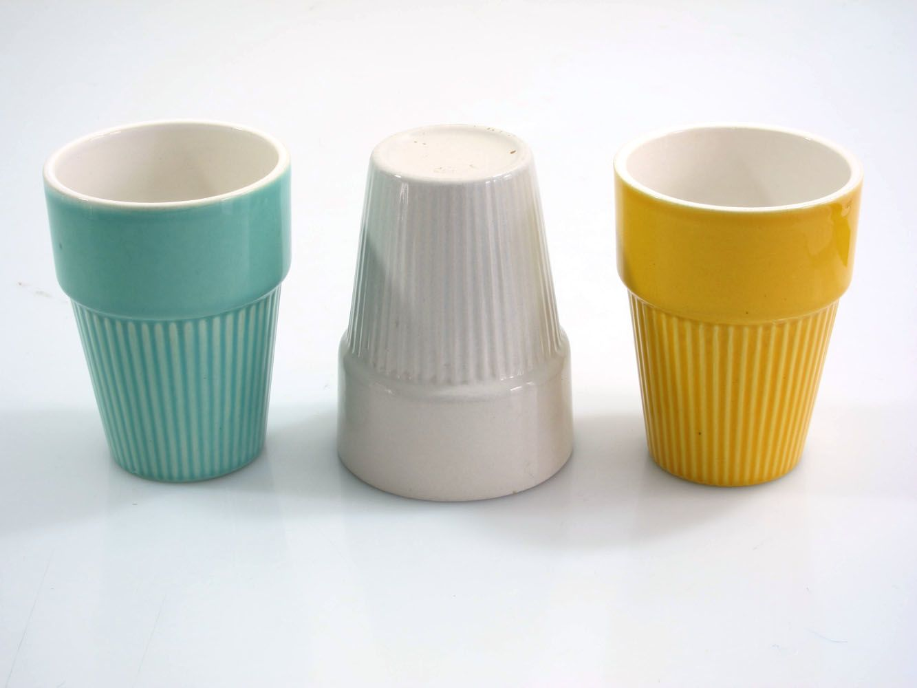 Nice set of vintage ceramic cups. Grey one has a slight manufacter error. See cup edge on picture. Dimensions: height 10 cm, diameter 7,5 cm.