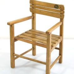 Dolls chair from the fifties. Front plank of the seat has been replaced. Otherwise in great condtion. Dimensions: height 30 cm, width 21 cm, depth 19 cm.