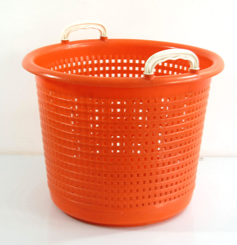 Orange plastic laundry basket sixties vintage