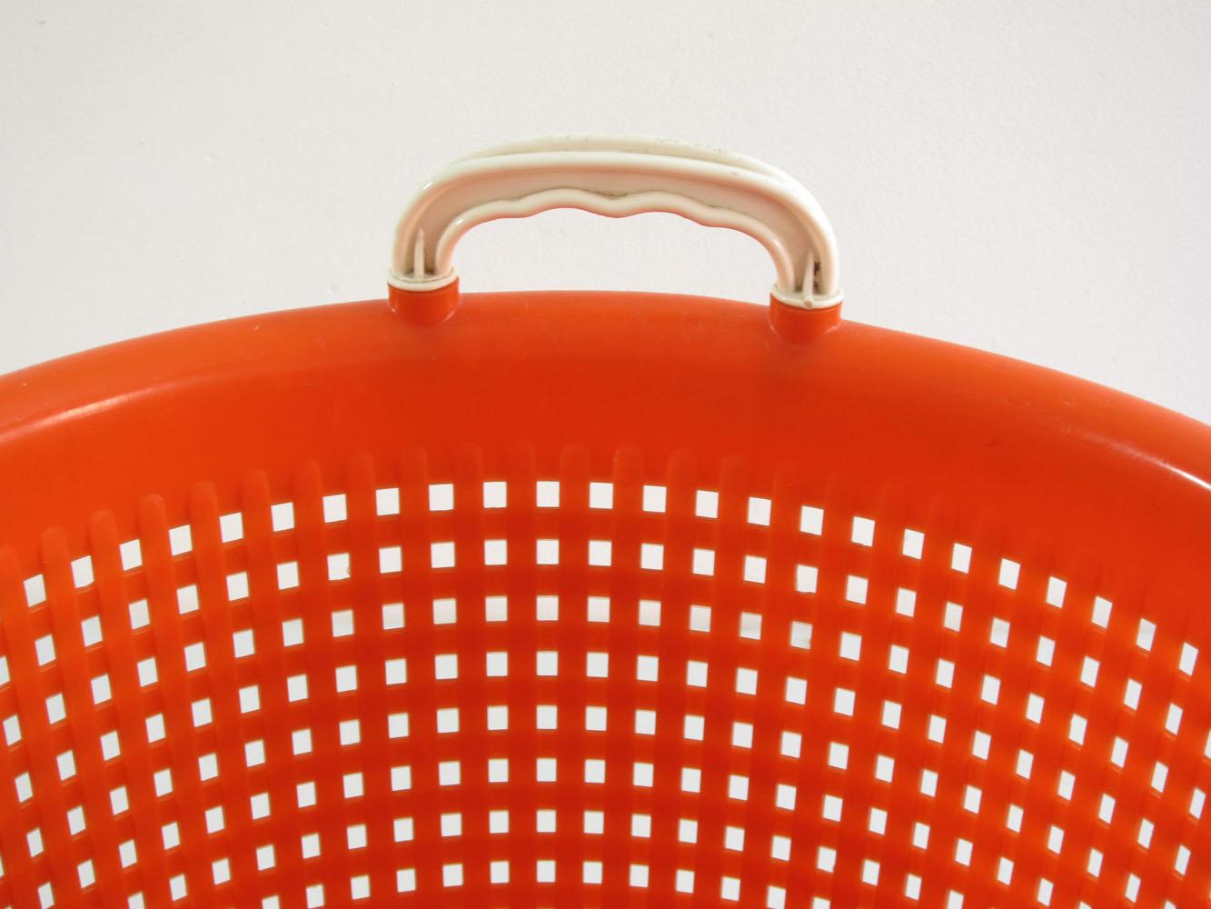 Orange plastic laundry basket sixties vintage