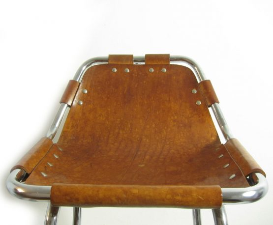 Charlotte Perriand Les Arcs sixties vintage design stool. Natural brown colour saddle leather has a great patina. In good looking vintage condition. Charlotte Perriand worked with Le Corbusier for ten years. She designed the chairs for the Les Arcs ski resort in France in the 1960s.